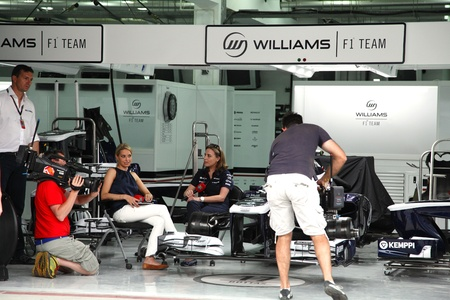 SHAKIR, BAHRAIN - APRIL 18: TV crew taking interview of a lady member of Williams Renault team on Thursday April 18, 2013,   Formula 1 Gulf Air Bahrain Grand Prix 2013  Editorial