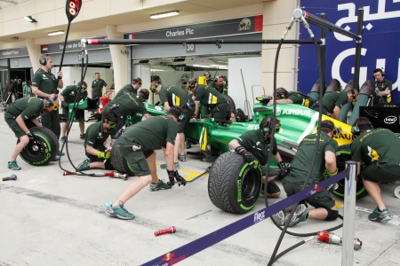 SHAKIR, BAHRAIN - APRIL 18: Caterham Renault doing practice of changing tyres and refuelling in front of Pit stop garage on   Thursday April 18, 2013, Formula 1 Gulf Air Bahrain Grand Prix 2013
