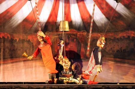 SANABIS, BAHRAIN - JUNE 29  Karromato Czech Marionette theater performs the act  wooden circus  during Bahrain Summer Festival on June 29, 2012 at Exhibition Centre, Sanabis, Bahrain