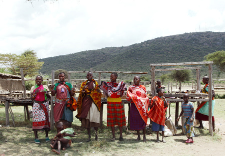 MASAI MARA, KENYA-OCTOBER 19  Masai women in traditional dress performs traditional folk dance at a Masai Mara Village, Kenya on October 19, 2013