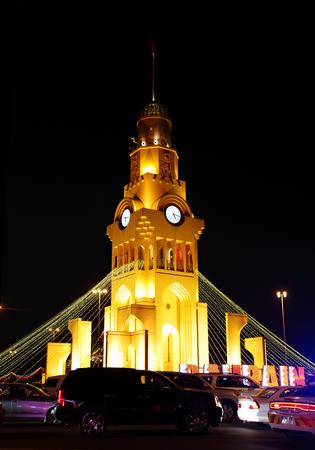 42nd: RIFFA, BAHRAIN - DECEMBER 17: Beautiful illuminated Riffa Clock Tower on 17 December, 2013 on the occasion of Bahrain 42nd National Day at Riffa, Bahrain