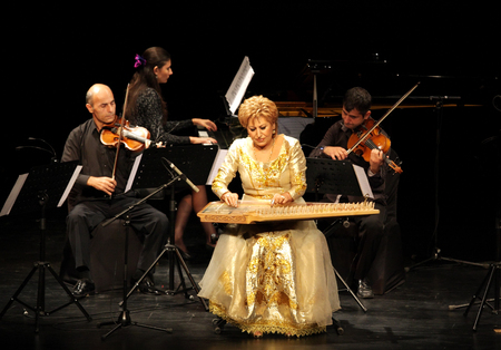 MANAMA, BAHRAIN - OCTOBER 01  Hasmik Leyloyan, the Queen of Qanun with her orchestra performs on October 01, 2012 in Bahrain on the occasion of the 21st Bahrain International music festival