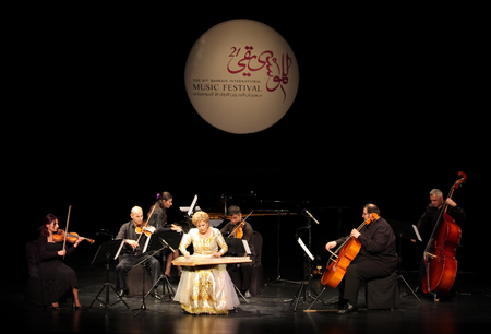 mesmerising: MANAMA, BAHRAIN - OCTOBER 01  Hasmik Leyloyan, the Queen of Qanun with her orchestra performs on October 01, 2012 in Bahrain on the occasion of the 21st Bahrain International music festival