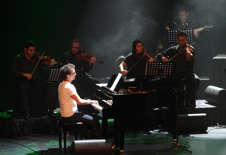 mesmerising: MANAMA, BAHRAIN - OCTOBER 02  Piano Pop Zade Dirani with his orchestra performs on October 02, 2012 in Bahrain on the occasion of the 21st Bahrain International music festival