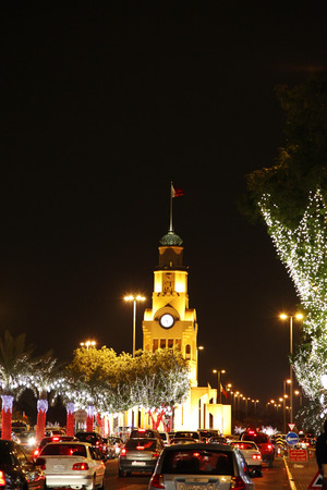 RIFFA, BAHRAIN - DECEMBER 14  Beautiful illuminated trees and Riffa Clock Tower on 14 December, 2012 on the occasion of Bahrain 41st National Day at Riffa,  Bahrain