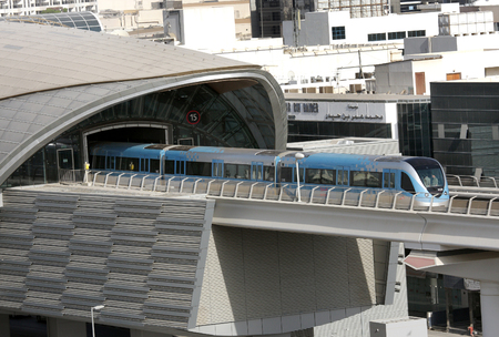 conditioned: DUBAI, UAE - SEPTEMBER 03: Train moving out from a metro station in Dubai, United Arab Emirates on September 03, 2011. The Dubai Metro is the longest driverless metro network in the world