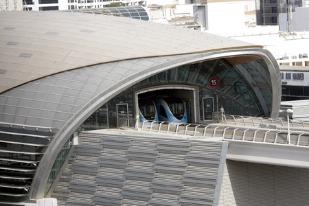 conditioned: DUBAI, UAE - SEPTEMBER 03: Both direction train stops at metro Station in Dubai, United Arab Emirates on September 03, 2011. The  Dubai Metro is the longest driverless metro network in the world