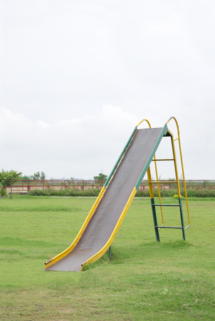 Children slide in a park photo