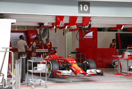pit stop: SHAKIR, BAHRAIN - APRIL 03: Pit stop garage of team Ferrari on Thursday April 03, 2014, Formula 1 Gulf Air Bahrain Grand Prix 2014  Editorial