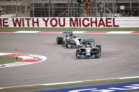 SHAKIR, BAHRAIN - APRIL 06: Lewis Hamilton & Nico Rosberg of Mercedes racing on Sunday final night race,   April 06, 2014, Formula 1 Gulf Air Bahrain Grand Prix 2014