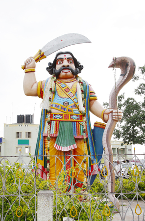 mahishasura: MYSORE, INDIA - JULY 28: The statue of the demon Mahishasura, the iconic image in Mysore tourism,  on July 28, 2012 at Mysore, India