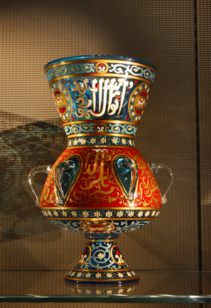 DOHA, QATAR - OCTOBER 26: Beautiful ancient Islamic Glass Vase in the Museum of Islamic Art in Doha on October 26, 2012, Qatar. It is one of the worlds most complete collections of Islamic artifacts