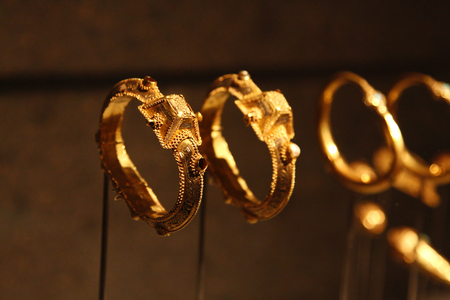 DOHA, QATAR - OCTOBER 26: Beautiful ancient gold bangles of Syria in the Museum of Islamic Art in Doha on October 26, 2012, Qatar. It is one of the worlds most complete collections of Islamic artifacts