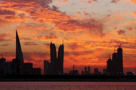 world trade center: Bahrain highrise buildings & spectacular clouds during sunset Stock Photo