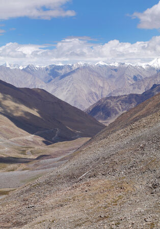 tethys: Snow carved valley and Karakoram Mountains from Khardung Pass, HDR