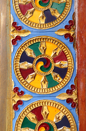 buddhist structures: A colourful wheel and murals engraved on Shanti Stupa