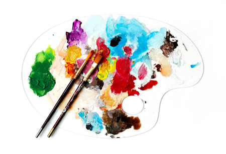 diluted: Clear Palette and brushes for acrylic painting Stock Photo