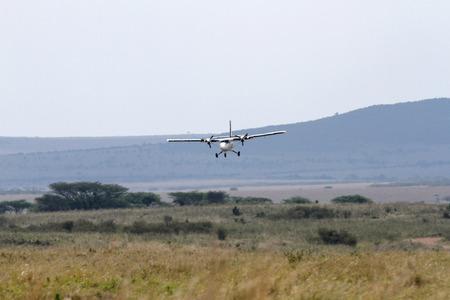 aircraft landing: KEEKOROK, KENYA-OCTOBER 21: Small Air Kenya aircraft landing on Keekorok airstrip on October 21, 2013, Keekorok, Masai Mara, Kenya