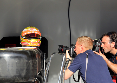 pit stop: Photographers taking photographs of displayed old Fernando Alonso helmet of 2012 at the Pit stop garage of team Mclaren with  on Thursday April 16 2015 Formula 1 Gulf Air Bahrain Grand Prix 2015 Editorial
