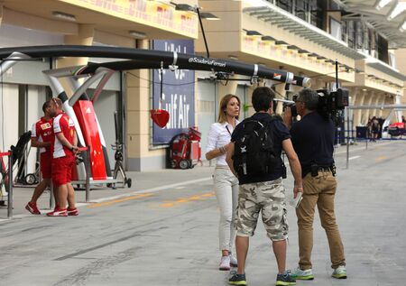 pit stop: Media persons recording in front of the Pit stop garage of Ferrari on April 16 2015  Formula 1 Gulf Air Bahrain Grand Prix 2015