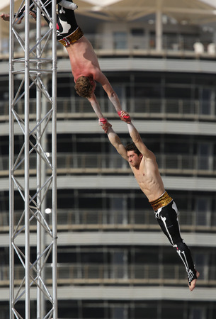 trapeze: Flying Trapeze Artists of Gorilla Circus performs at Formula 1 village vending area  entertainment on Friday April 17 2015 Formula 1 Gulf Air Bahrain Grand Prix 2015