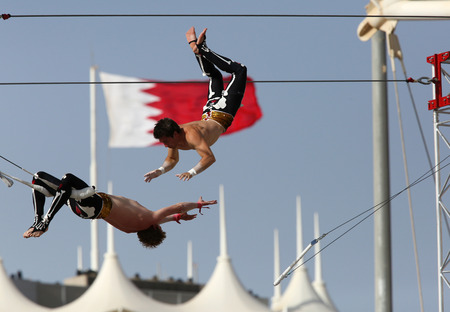 Flying Trapeze Artists of Gorilla Circus performs at Formula 1 village vending area  entertainment on Friday April 17 2015 Formula 1 Gulf Air Bahrain Grand Prix 2015