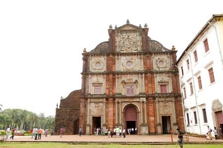 mortal: GOA INDIA AUGUST 11: The facade of ancient Basilica of Bom Jesus church on August 11 2014 Goa. The basilica church holds the mortal remains of St. Francis Xavier.
