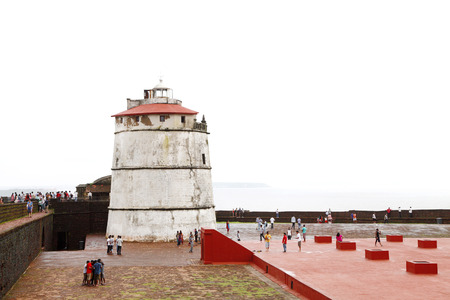 aguada: GOA INDIA AUGUST 10: Ancient Aguada fort and its beautiful restored lighthouse on August 10 2014 Goa. The fort was constructed in 1613 to guard against the Dutch and the Marathas