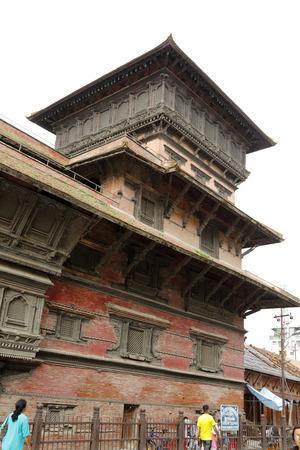 closed community: KATHMANDU NEPALAUGUST 21: The Basantapur Tower located on the south of Nasal Chowk in Hanuman Dhoka Durbar on August 21 2014 at Kathmandu Nepal. It is a ninestorey tower.
