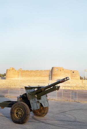 break fast: MUHARRAQ, BAHRAIN-JULY 08: A cannon near the Arad Fort ready to fire at sunset as a signal to break the evening fast during Ramadan at Muharraq, Bahrain on July 08, 2014