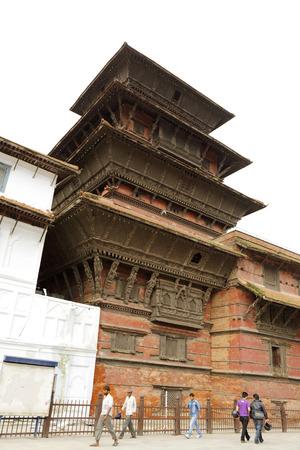 closed community: KATHMANDU, NEPAL-AUGUST 21: The Basantapur Tower located on the south of Nasal Chowk in Hanuman Dhoka Durbar on August 21, 2014 at Kathmandu, Nepal. It is a nine-storey tower.