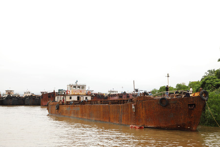 mining ship: GOA INDIA AUGUST 10: Huge iron ore cargo ship stranded in the bank of Zuari river after the ban of mining on  August 10 2014 Goa