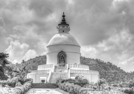 buddhist structures: POKHARA NEPALAUGUST 22: The beautiful Pokhara Shanti Stupa on Ananda hilltop August 22 2014 Pokhara Nepal. Shanti Stupa is the shrine build as symbol of peace