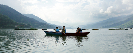 phewa: POKHARA NEPALAUGUST 22: Tourists enjoying boat ride in vast Phewa Lake on August 22 2014 Pokhara Kathmandu Nepal. Phewa lake is located at an altitude of 742 m Editorial