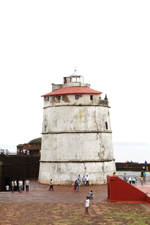 ocea: GOA INDIA AUGUST 10: Ancient Aguada fort and its beautiful restored lighthouse on August 10 2014 Goa. The fort was constructed in 1613 to guard against the Dutch and the Marathas