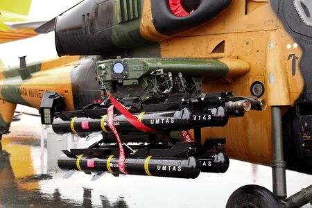 long range: SAKHIR AIRBASE, BAHRAIN - JANUARY 18: Static display of ATAK T129 Helicopter with Long range anti-tank missile system in Bahrain International Airshow at Sakhir Airbase, Bahrain on 16 January, 2014 Editorial