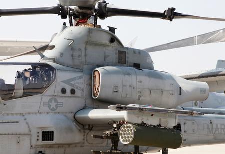 usaf: SAKHIR AIRBASE, BAHRAIN - JANUARY 16: Static display of USAF Bell AH-1 Cobra with rocket launcher in Bahrain International Airshow at Sakhir Airbase, Bahrain on 16 January, 2014