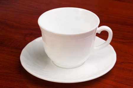 Bright empty cup and saucer isolated on white background Stock Photo - 13047001