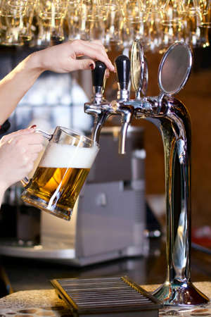 waiting woman pouring beer into the glass