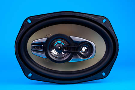 Auto audio system loud speaker for car isolated on blue photo