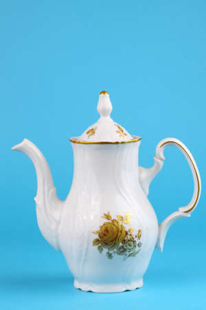 Coffee pot from czech service white with ornament roses isolated on blue Stock Photo - 13319677