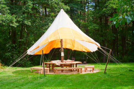 outdoor big open tent on a meadow Stock Photo - 13587081