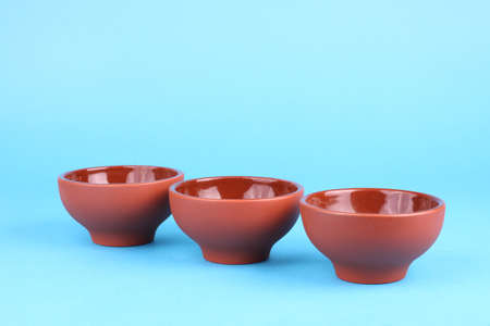 Arabian old ceramic brown teacups isolated on blue Stock Photo - 13627925