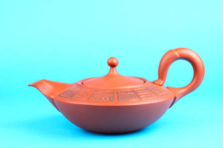Arabian old ceramic brown teapot with ornament isolated on blue Stock Photo - 13657707