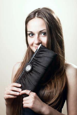 young woman with beautiful makeup and handbag photo