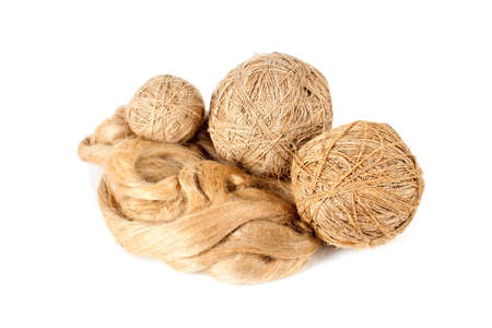 flack: Flack ball of linen yarn and raw flux isolated over white background Stock Photo