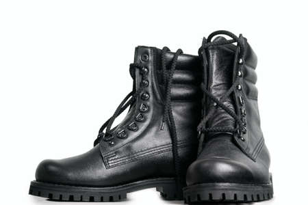 steel toe boots: The high black leather boots isolated on white background