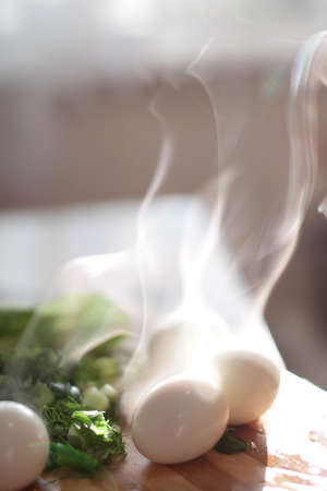 cool down: Smoking eggs cool down before going to salad Stock Photo