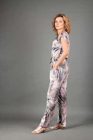 picture of lovely woman in playsuit over gray Stock Photo - 14158908