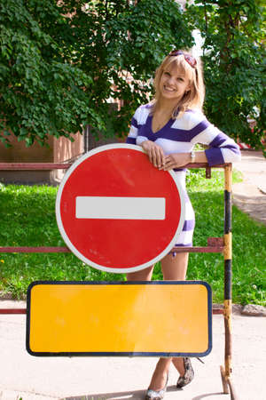 area sexy: Young woman staning over the warning road signes